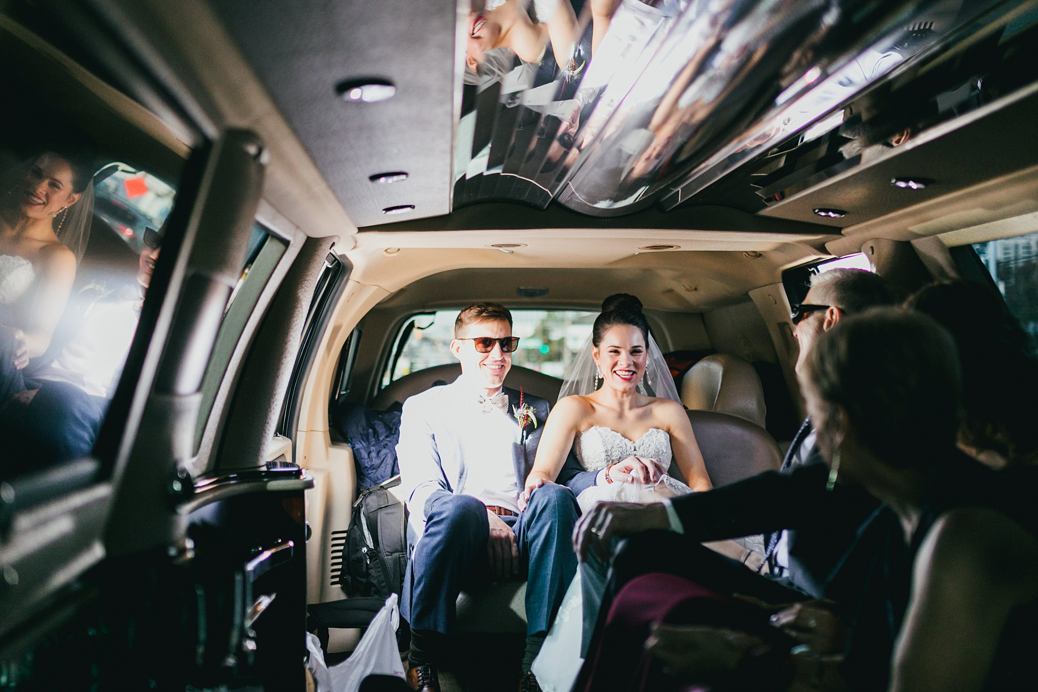 Atlanta Wedding Photographers Love & Story Bride and Groom in Limo